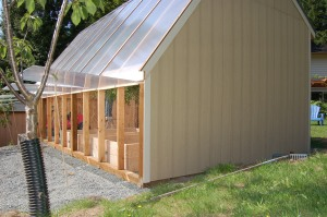 Polycarbonate siding on greenhouse